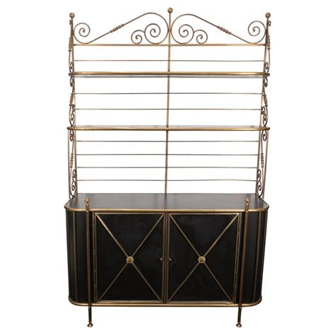 Bakers Rack With Storage Cabinets by Freestanding Bakers Rack In Brass And Bronze With Black