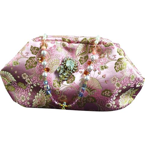 vintage pink brocade evening bag with a miriam haskell pin