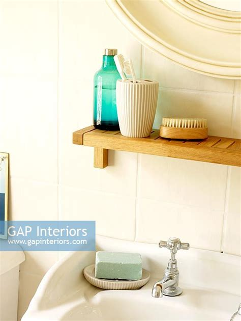 shelf above bathroom sink gap interiors detail of bathroom sink with shelf above
