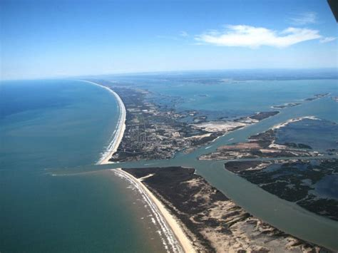 aransas pass boat rental st jo island in foreground and port aransas across the
