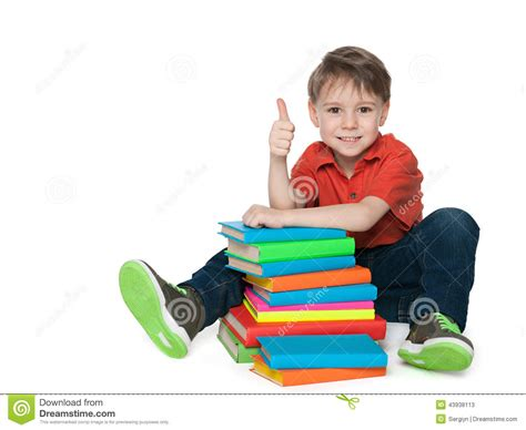 thumbs up my brown boy books sitting near books cheerful boy stock photo image 43938113