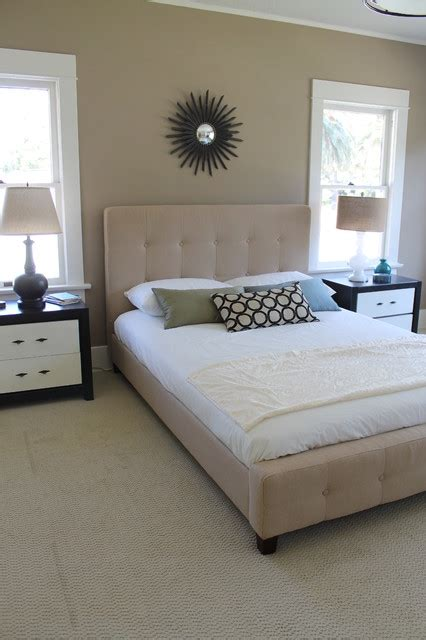 transitional bedroom with tufted upholstered headboard