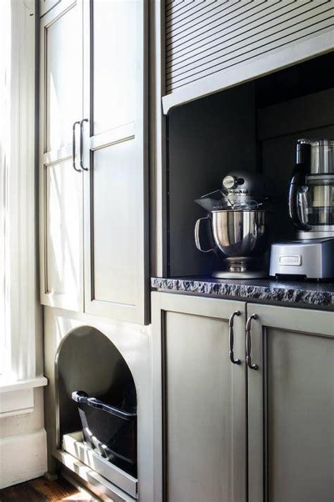 kitchen appliances cabinet  gray garage door