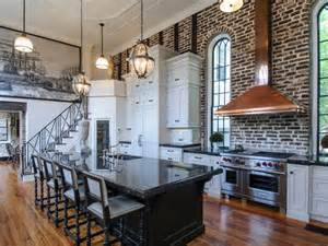 white loft style kitchen with exposed brick wall and black