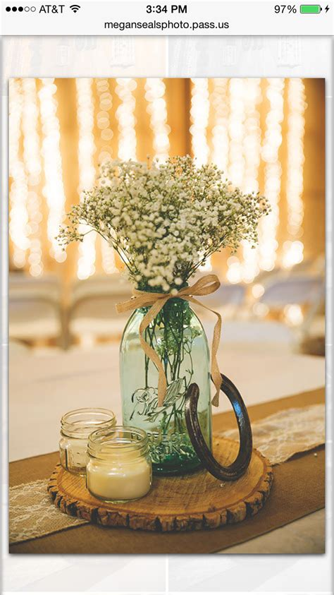 some of my centerpieces at my wedding horse shoe was a