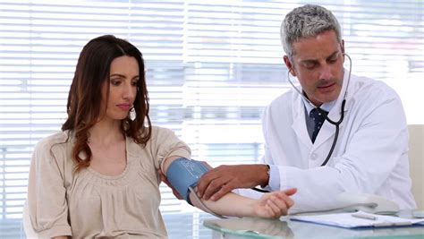 what did the doctor see in his room doctor taking the blood pressure of a patient in an examination room stock footage 3034327