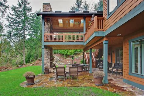 Cabin House Plans Covered Porch by Two Level Covered Deck Rustic Deck Seattle By
