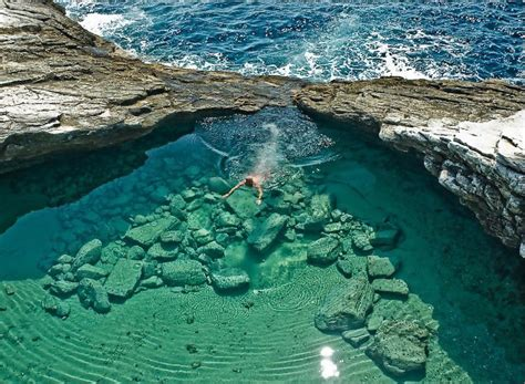 turquoise pool giola lagoon greece photo  sunsurfer