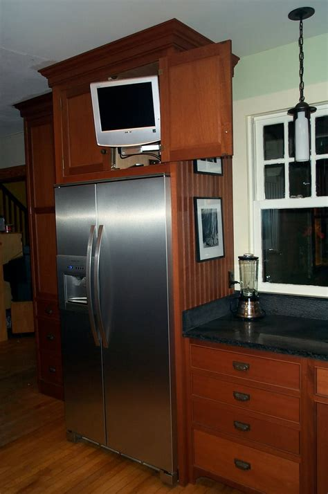 tv above refrigerator kitchen ideas pinterest cabinets over the refrigerator in my hummel opinion