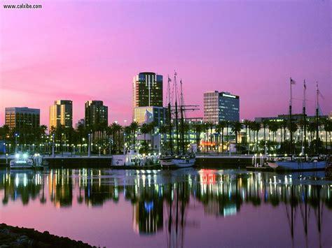 buildings city harbor sunset long beach california