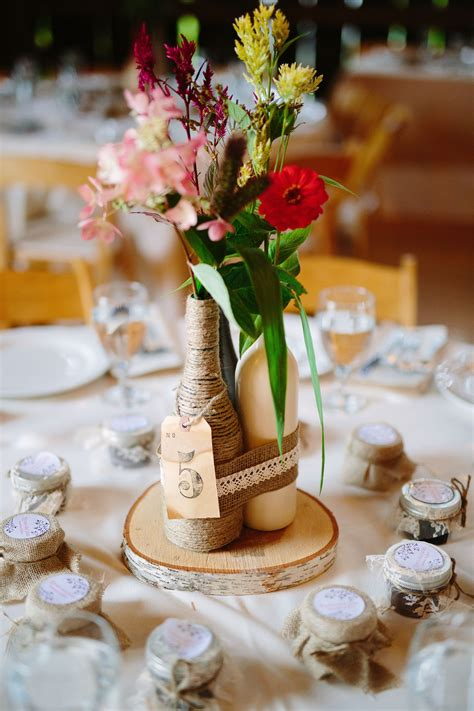 diy rustic wine bottle centerpiece wedding reception