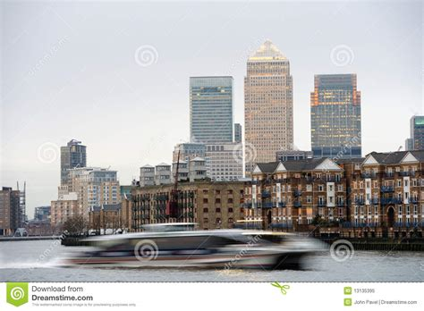 fast boat in london fast boat on thames london canary wharf at back stock
