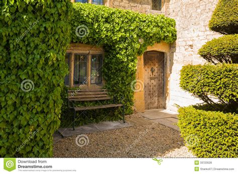 shadow front bench entrance door of an old house royalty free stock photos