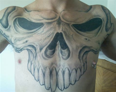 tattoo breast skull chest tattoos skull and chest