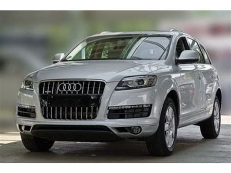 compare audi q7 and jeep grand which is better