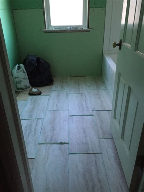 how to lay vinyl tiles in bathroom which direction should i lay the 12x24 vinyl tiles in our