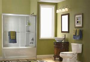 Green bathroom with vessel sink and shower
