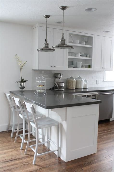white cabinets gray counters wood floors  love