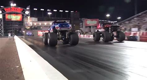 monster truck drag racing video bigfoot monster truck takes on jet car in