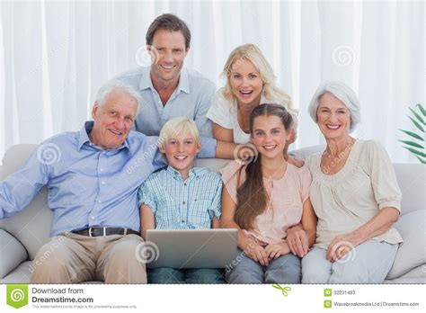 couch family parents sit on sofa with 28 images family sitting