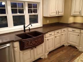 brown concrete countertops backsplash with white cabinets