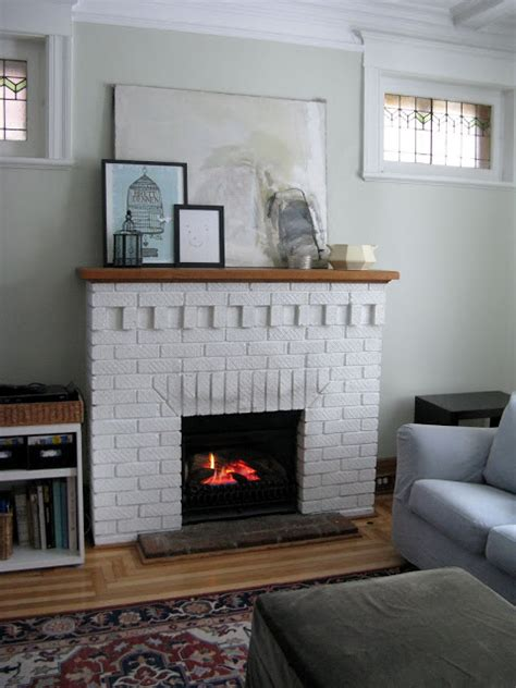 white painted brick fireplaces