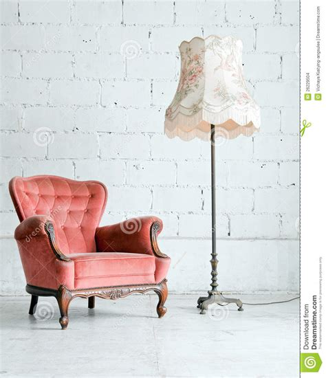 armchair  desk lamp  vintage room stock images