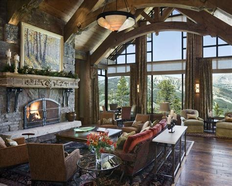 rustic great room  trusses large stone fireplace