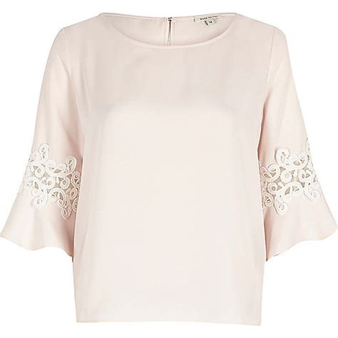 light pink sleeve top light pink lace trim bell sleeve top blouses tops
