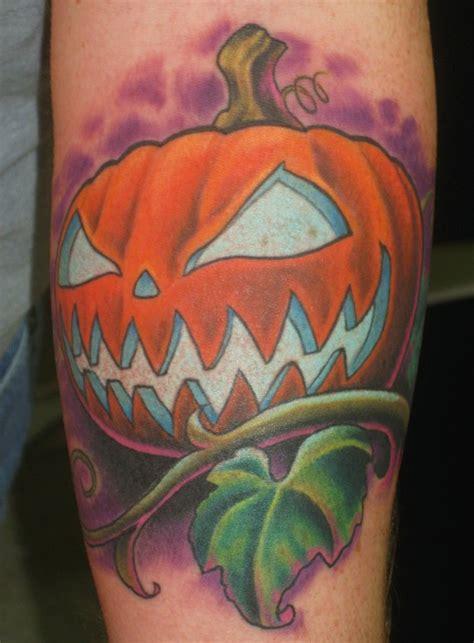 new school pumpkin tattoo jack o lantern by tim senecal tattoos