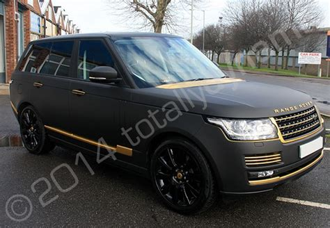 black and gold range rover range rover vogue fully wrapped in a matt black vinyl car