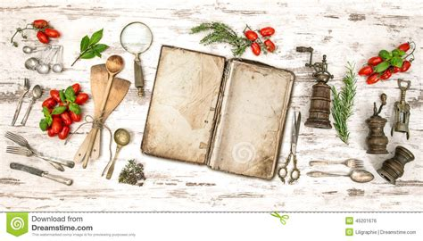 Menu Di Spatula Kitchen Bali cookbook with vegetables herbs and vintage kitchen utensils stock photo image 45201676
