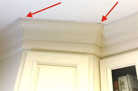 how to fill gap between cabinet and ceiling crown molding gap at ceiling fix with caulk avoid with