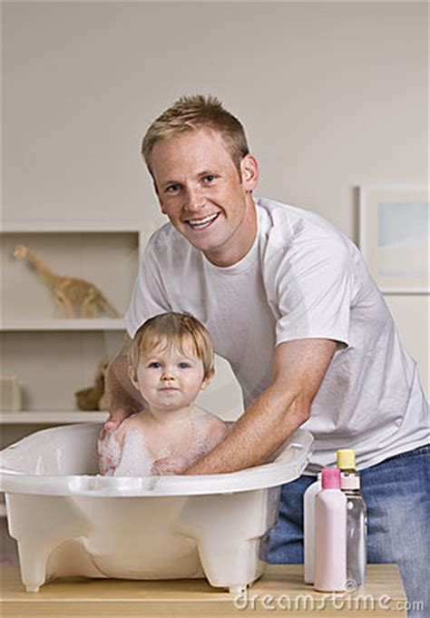 dad daughter in bathroom father giving daughter a bath stock photos image 10196313