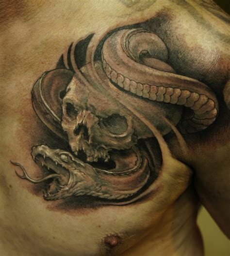 snake and skull tattoo black ink skull and snake on chest tattooimages biz
