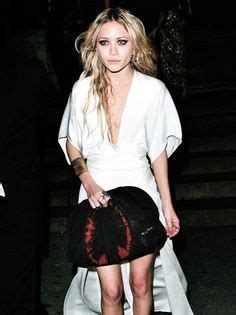 Kate With Miu Miu Pleated Tie Dye Clutch by Kate And Look Carefree During Their