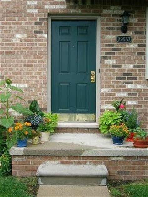 dark teal door shutters creamy white stucco  brown