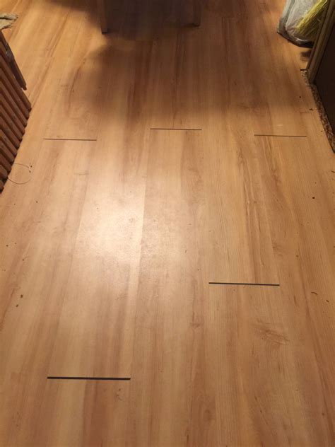 The vinyl plank click flooring I installed in two rooms