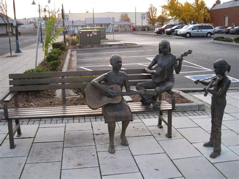 three figures and four benches bench band sculptures medford oregon musical