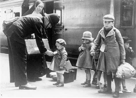 children and world war 1445105799 a policeman helps young evacuees and the nun escorting them at a london station on 18 may 1940