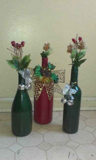 decorate wine bottle for christmas decor spray painted wine bottles with decorations from the dollar tree