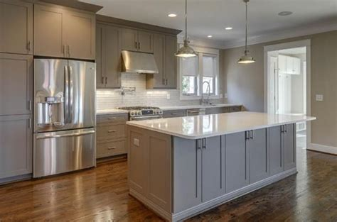 white kitchen cabinets with grey countertops medium gray cabinets with white countertop and dark floor