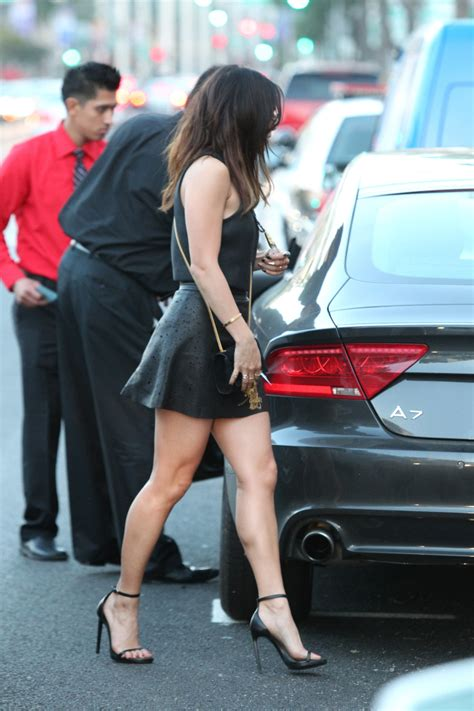 high heels and mini skirts hudgens legs in a leather mini skirt and
