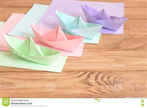 origami boat with square origami square paper origami plane on the white