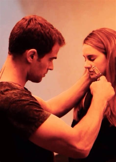 new divergent still of four and tris preparing to go into