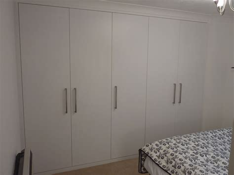 contemporary style fitted storage cupboard by peter