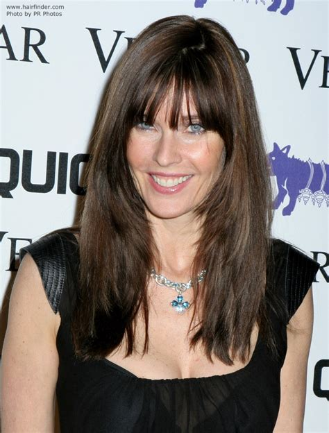 carol alt long haircut angled on the sides and falling carol alt long textured and centered brunette hairstyle