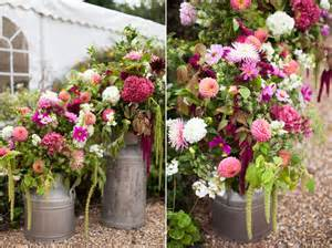 Garden wedding in a marquee with paper lanterns and beautiful flowers