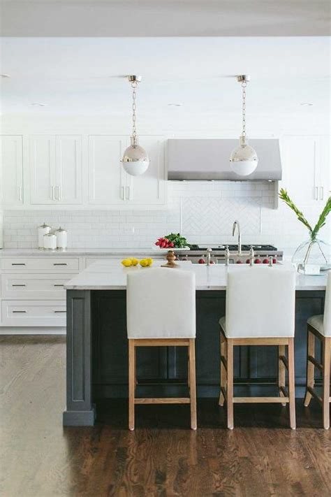 white kitchen island with stools white camelback counter stools transitional kitchen