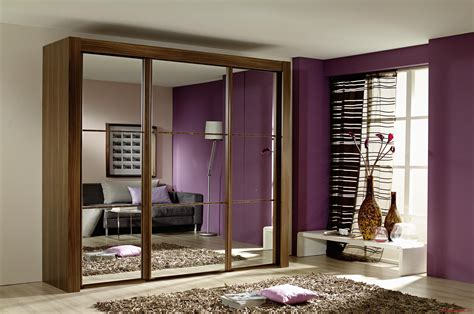 Modern Bedroom Closet Doors Amazing Modern Small Bedroom With Brown Laminated Wooden